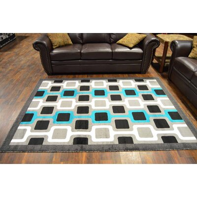 Cottrill Turquoise/Black Area Rug