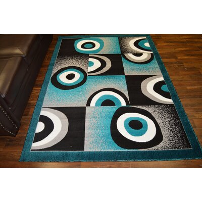 Costin Turquoise/Black Area Rug