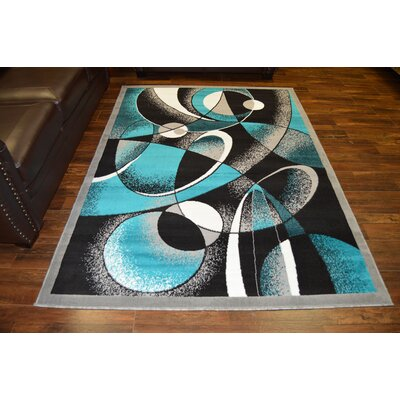 Cothern Turquoise/Black Area Rug