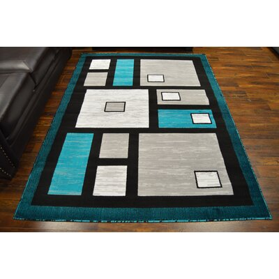 Coto Turquoise/Black Area Rug