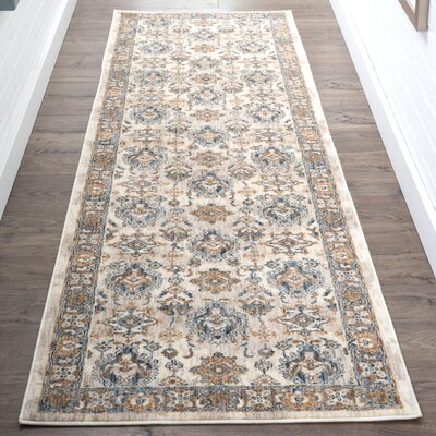 Matteson Traditional Ivory/Orange Area Rug Rug Size: Runner 23 x 11