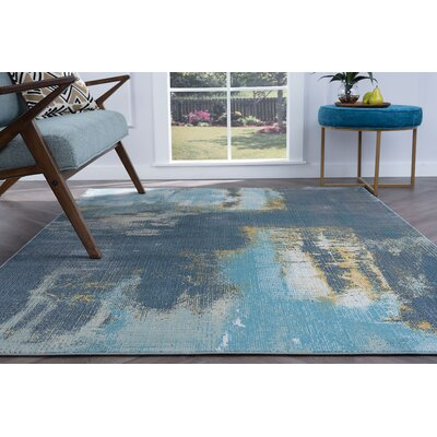 Ceasar Modern Rectangle Blue Area Rug Rug Size: 710 x 103