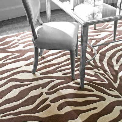 Tufted Animal Print Area Rug Rug Size: 10 x 14