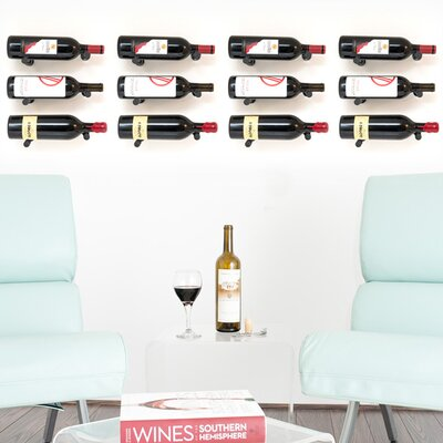 Vino Pins 12 Bottle Wall Mounted Wine Bottle Rack Finish: Anodized Black