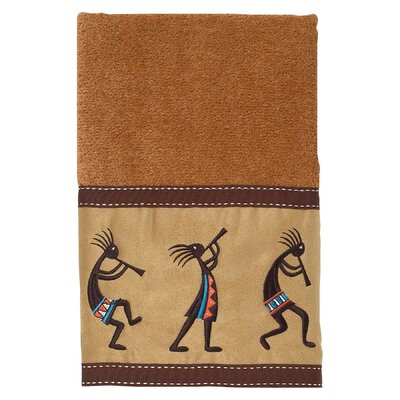 Kokopelli Hand Towel Color: Nutmeg