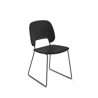 Ravsten Upholstered Dining Chair Upholstery: Black Leather, Finish: Chrome