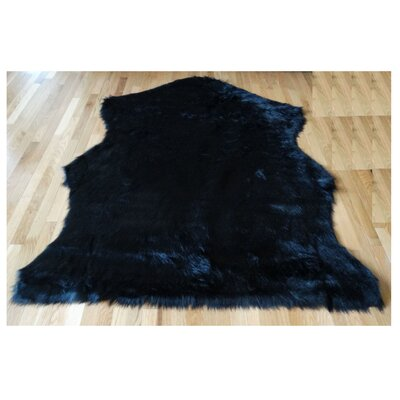 Animal Hide Black Sheep Fur Area Rug Rug Size: 5 x 7