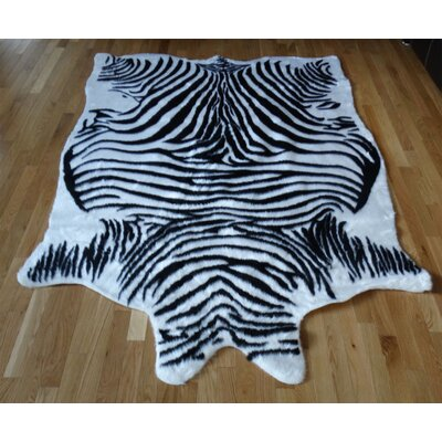 Animal Hide Black/White Zebra Fur Area Rug Rug Size: 5 x 7