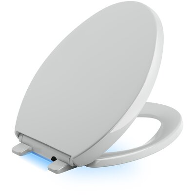 Reveal Nightlight Quiet-Close with Grip-Tight Elongated Toilet Seat Finish: Ice Grey