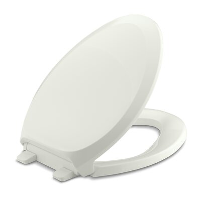 French Curve Quiet-Close with Grip-Tightelongated Toilet Seat Finish: Dune