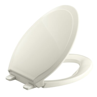 Rutledge Quiet-Close with Grip-Tightelongated Toilet Seat Finish: Biscuit