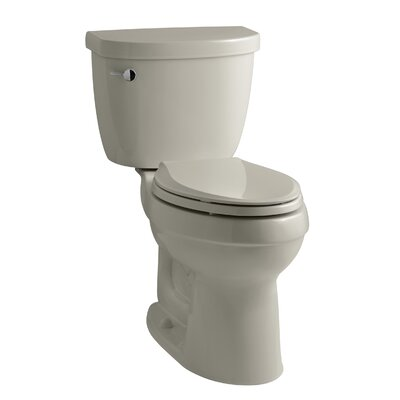 Cimarron Comfort Height Two-Piece Elongated 1.28 GPF Toilet with Aquapiston Flush Technology and Left-Hand Trip Lever Finish: Sandbar
