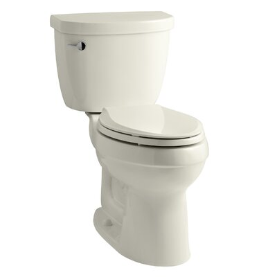 Cimarron Comfort Height Two-PieceToilet with Aquapiston Flush Technology and Left-Hand Trip Lever Finish: Biscuit