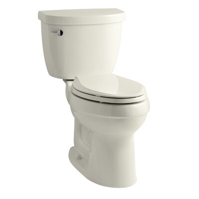Cimarron Comfort Height Two-Piece Elongated 1.6 GPF Toilet with Aquapiston Flush Technology, Left-Hand Trip Lever and Tank Locks Finish: Biscuit