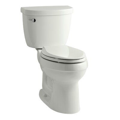 Cimarron Comfort Height Two-Piece Elongated 1.28 GPF Toilet with Aquapiston Flush Technology, Left-Hand Trip Lever and Insuliner Tank Liner Finish: Dune