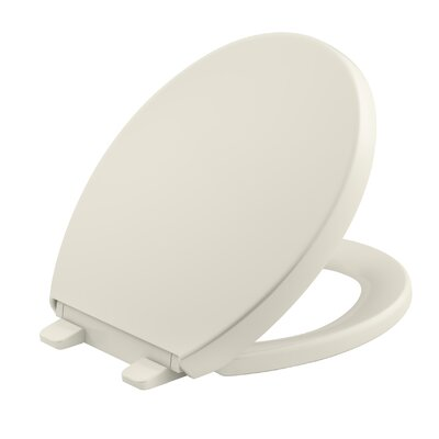 Reveal Quiet-Close with Grip-Tight Round-Front Toilet Seat Finish: Biscuit