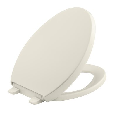 Reveal Quiet-Close with Grip-Tight Elongated Toilet Seat Finish: Biscuit