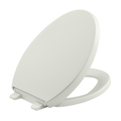 Reveal Quiet-Close with Grip-Tight Elongated Toilet Seat Finish: Dune