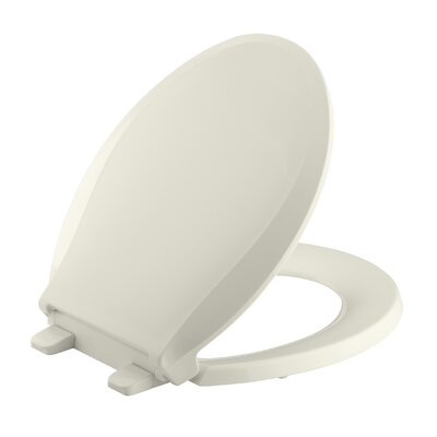 Cachet Quiet-Close with Grip-Tight Round-Front Toilet Seat Finish: Biscuit