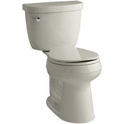 Cimarron Comfort Height Two-Piece Round-Front 1.6 GPF Toilet with Aquapiston Flush Technology and Left-Hand Trip Lever Finish: Sandbar
