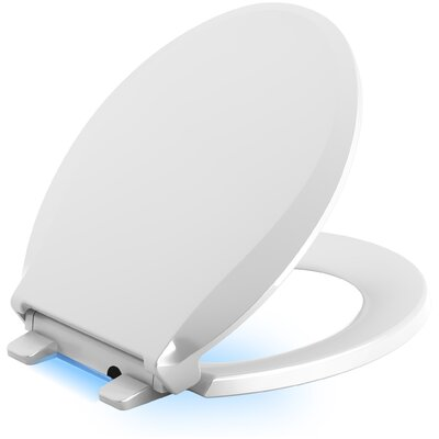 Cachet Nightlight Quiet-Close with Grip-Tight Round-Front Toilet Seat Finish: White