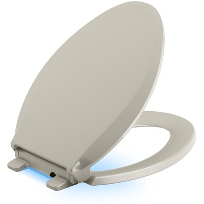 Cachet Nightlight Quiet-Close with Grip-Tight Elongated-Front Toilet Seat Finish: Sandbar