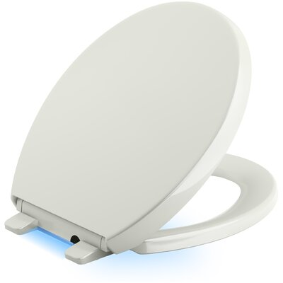 Reveal Nightlight Quiet-Close with Grip-Tight Round-Front Toilet Seat Finish: Dune