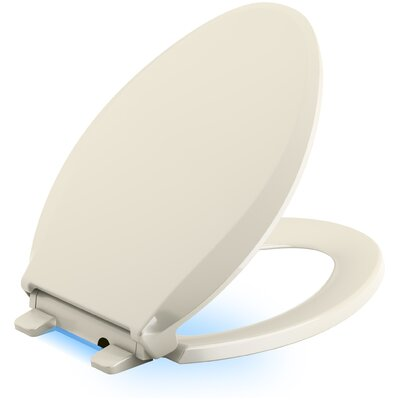 Cachet Nightlight Quiet-Close with Grip-Tight Elongated-Front Toilet Seat Finish: Almond