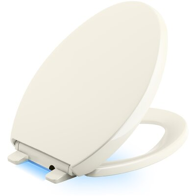 Reveal Nightlight Quiet-Close with Grip-Tight Elongated-Front Toilet Seat Finish: Biscuit