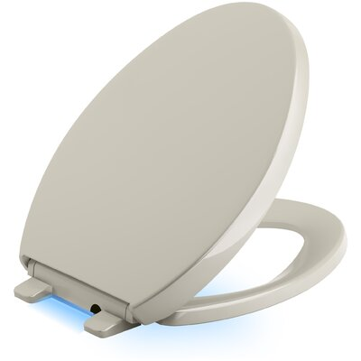 Reveal Nightlight Quiet-Close with Grip-Tight Elongated-Front Toilet Seat Finish: Sandbar