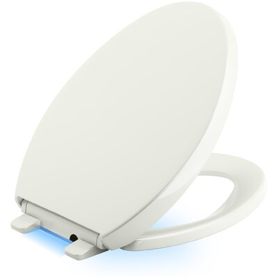 Reveal Nightlight Quiet-Close with Grip-Tight Elongated-Front Toilet Seat Finish: Dune