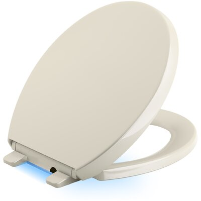 Reveal Nightlight Quiet-Close with Grip-Tight Round-Front Toilet Seat Finish: Almond