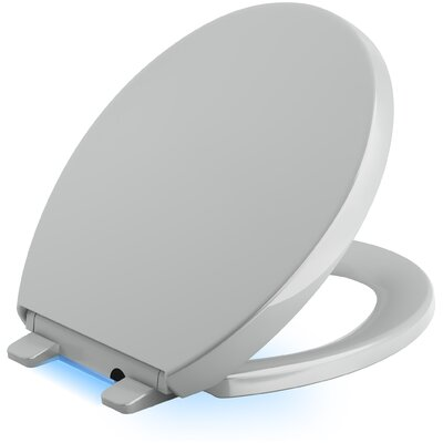 Reveal Nightlight Quiet-Close with Grip-Tight Round-Front Toilet Seat Finish: Ice Grey