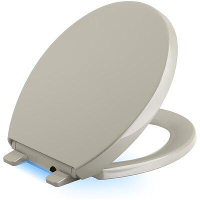 Reveal Nightlight Quiet-Close with Grip-Tight Round-Front Toilet Seat Finish: Sandbar