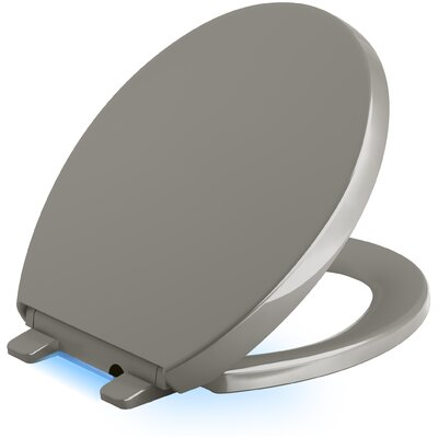 Reveal Nightlight Quiet-Close with Grip-Tight Round-Front Toilet Seat Finish: Cashmere