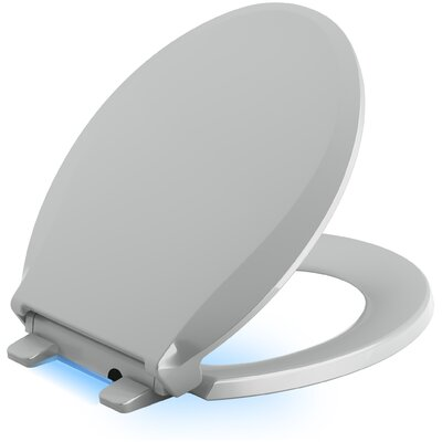 Cachet Nightlight Quiet-Close with Grip-Tight Round-Front Toilet Seat Finish: Ice Grey