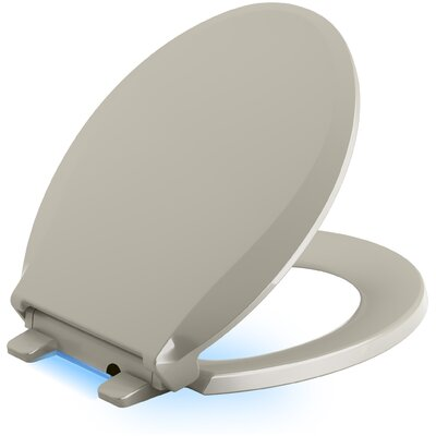Cachet Nightlight Quiet-Close with Grip-Tight Round-Front Toilet Seat Finish: Sandbar