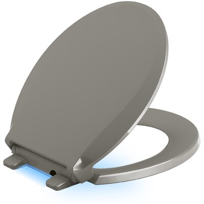 Cachet Nightlight Quiet-Close with Grip-Tight Round-Front Toilet Seat Finish: Cashmere