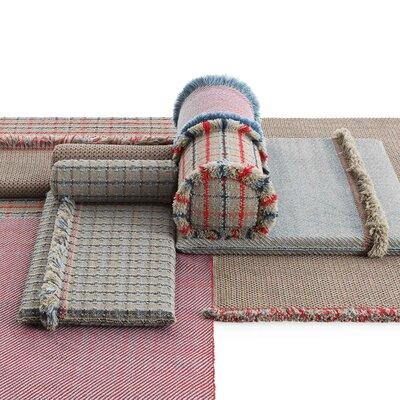 Garden Layers Diagonal Outdoor Bolster Color: Almond/Blue