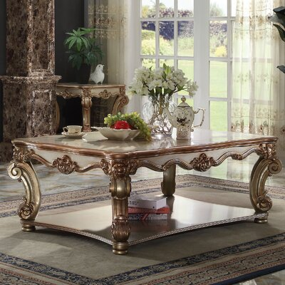 Welles Traditional Coffee Table Color: Gold Patina