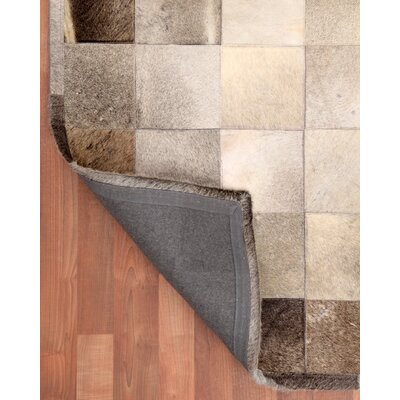 Cowhide Patchwork Polo Grey Area Rug Rug Size: 5 x 8