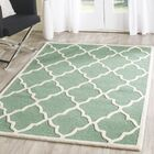 Charlenne Hand-Tufted Teal/Ivory Area Rug Rug Size: Rectangle 5' x 8'