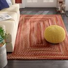 Holcombe Red Wool Hand Braided Area Rug Rug Size: Concentric 8' x 11'
