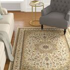 Knighten Classic Medallion Ivory/Beige Area Rug Rug Size: Rectangle 6'7
