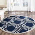 Wilkin Dark Blue/Ivory Area Rug Rug Size: Round 5'