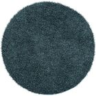 Mchaney Hand-Tufted Teal/Black Area Rug Rug Size: Round 9'