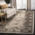 Maoli Ivory/Brown Area Rug Rug Size: Rectangular 5'3