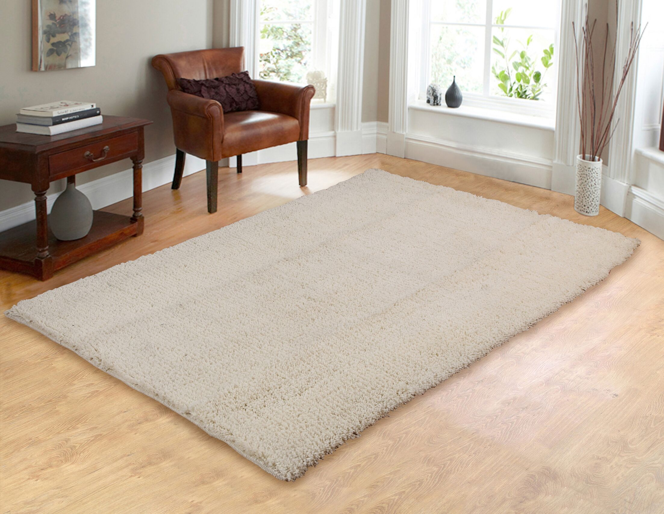 Hand-Woven Shag Ivory Area Rug Rug Size: 5' x 7'