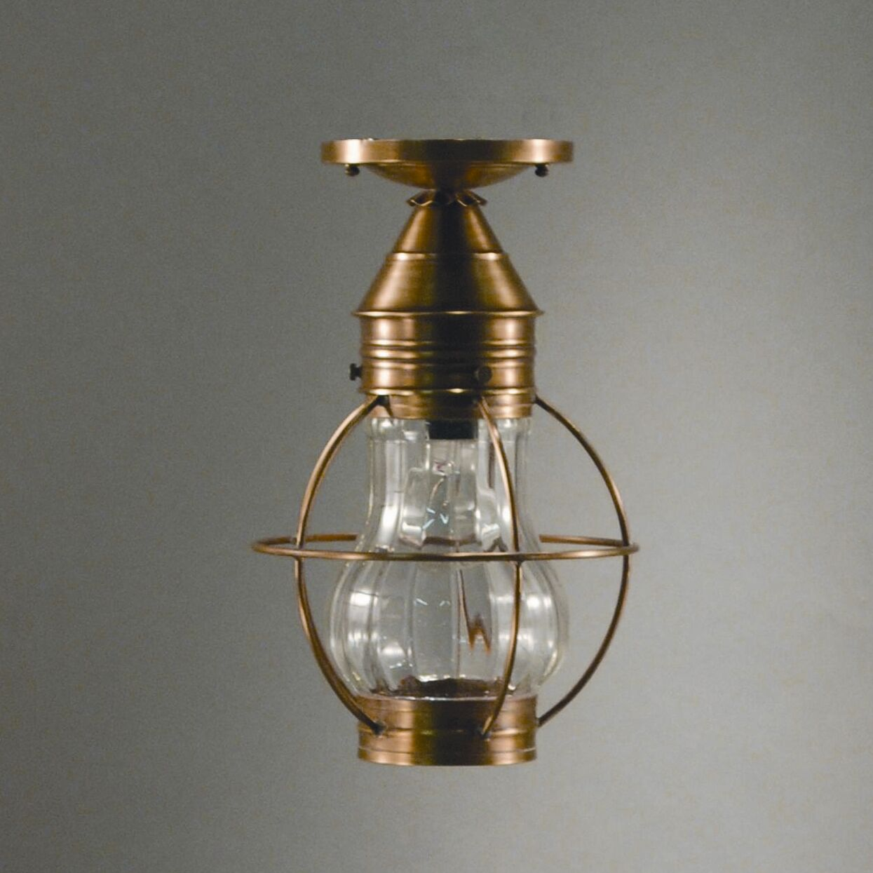 Onion Socket Caged Pear Semi Flush Mount Finish: Dark Antique Brass, Shade Color: Clear Seedy