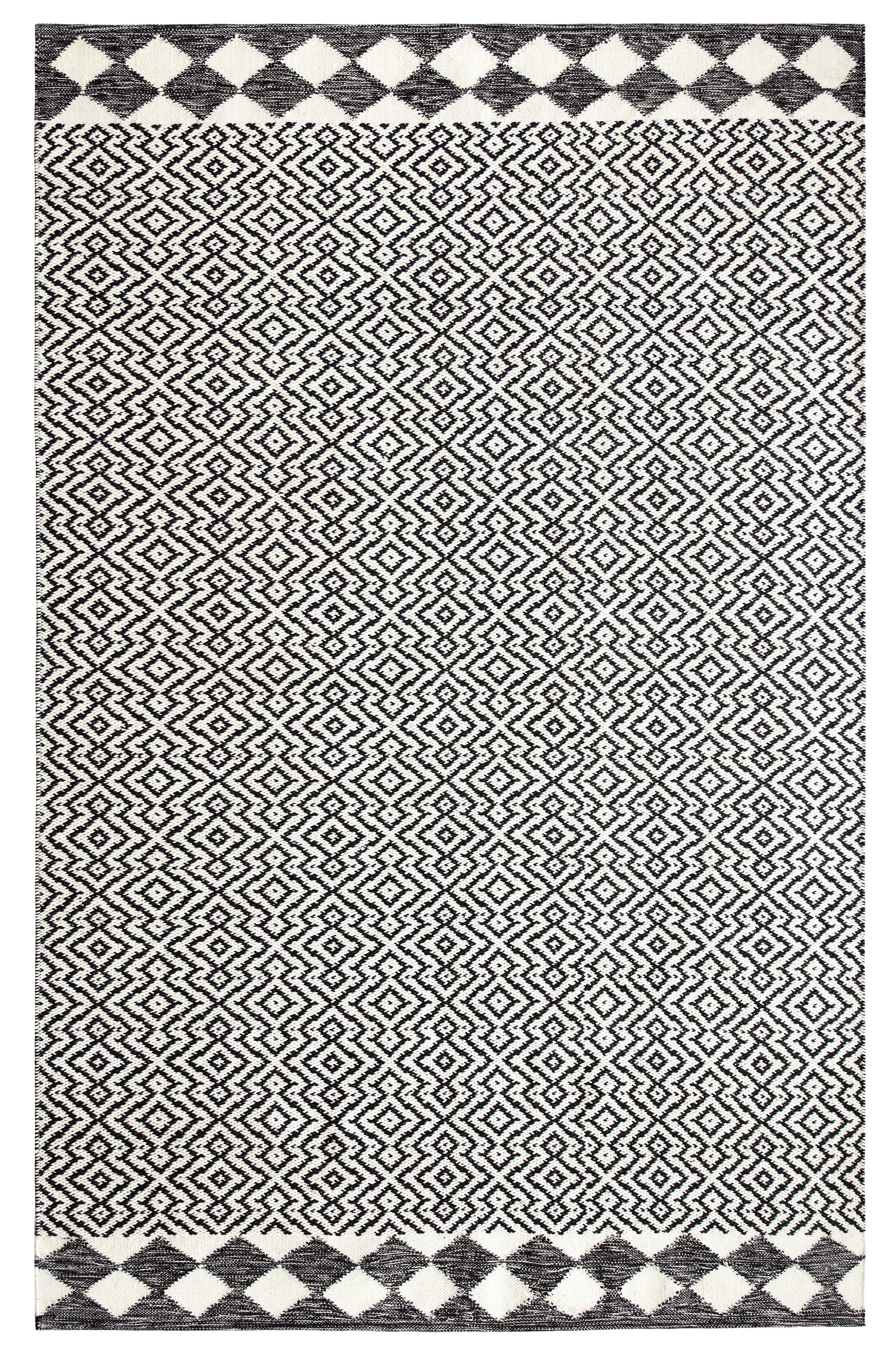 Odeon Hand-Woven Black Indoor/Outdoor Area Rug Rug Size: Rectangle 5' x 8'